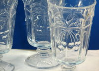 Embossed cherry pattern footed glassware