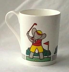 Elephant playing golf Studio Nova china mug
