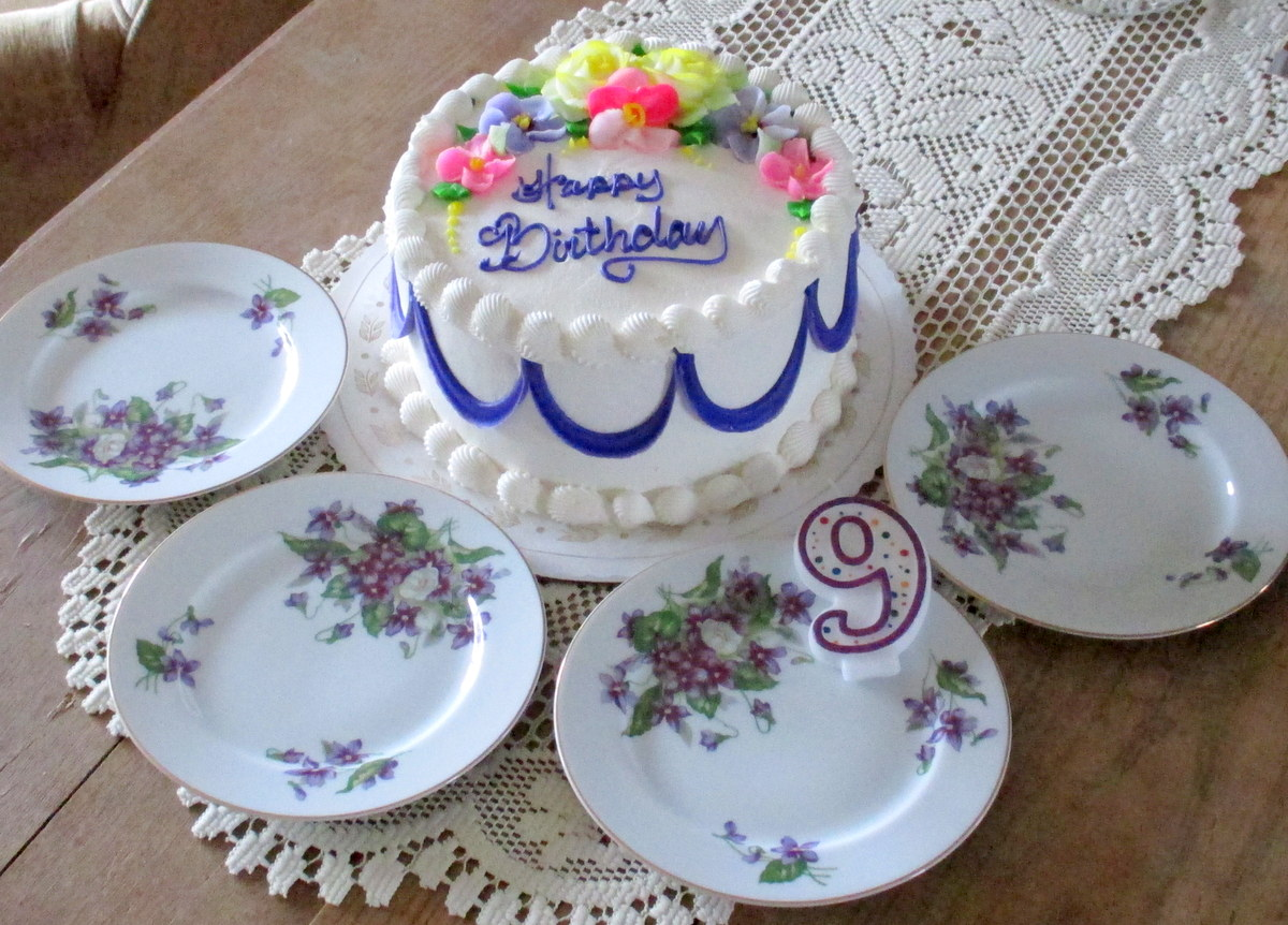 Birthday cake and vintage china plates